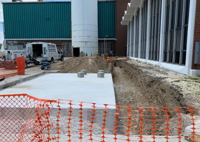 Construction outside of Administrative Building and smokestack